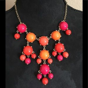 Top off any outfit with this colorful necklace!